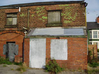 Derelict building in playing fields